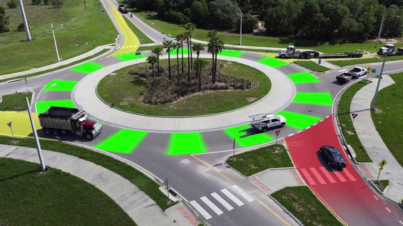 Image of trucks navigating a roundabout